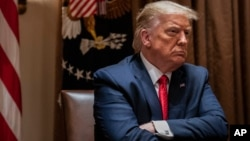 FILE - President Donald Trump listens during a White House meeting in Washington, July 9, 2020. On Thursday, a federal judge dismissed a lawsuit by Trump seeking to block the release of eight years of his personal and corporate tax records.