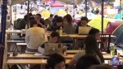 数周抗议 香港学生示威者不废学业