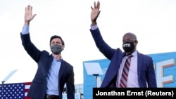 USA-ELECTION/GEORGIA-BIDEN Jon Ossoff and Raphael Warnock