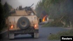 Xe của Lực lượng Đặc nhiệm Afghanistan bị tiêu diệt trong cuộc đụng độ với Taliban ở tỉnh Kandahar, Afghanistan, vào ngày 13/7/2021.