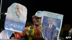 FILE - People celebrate the presidential election victory by Mauritania's ruling party candidate Mohamed Ould Ghazouani in Nouakchoot on June 23, 2019.