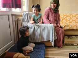 Marwa al-Awas, Mohammed's wife, fears travel to Europe but sees no other way to educate her children, April 17, 2021. (Heather Murdock/VOA)