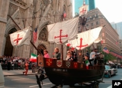 """FILE - In this Oct. 14, 1996 photo, a model of the """"Santa Maria,"""" one of Christopher Columbus' three ships, is pulled up New York's Fifth Avenue in front of St. Patrick's Cathedral during the 56th Columbus Day Parade."""