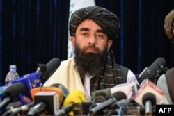 Taliban spokesperson Zabihullah Mujahid looks on as he addresses the first press conference in Kabul on Aug. 17, 2021 following the Taliban stunning takeover of Afghanistan.