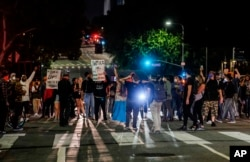 Demonstrators block traffic during a protest, May 27, 2020, in Los Angeles over the death of George Floyd in Minneapolis police custody earlier in the week.