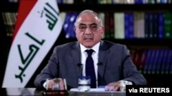 FILE - A still image taken from a video shows Iraqi Prime Minister Adel Abdul Mahdi delivering a speech on reforms, in Baghdad, Iraq Oct. 25, 2019.