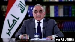 FILE - A still image taken from a video shows then-Iraqi Prime Minister Adel Abdul-Mahdi delivering a speech on reforms ahead of planned protest, in Baghdad, Oct. 25, 2019.