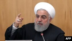"A handout picture provided by the Iranian presidency shows the Islamic republic's President Hassan Rouhani chairing a cabinet meeting in Tehran on January 15, 2020. - Iranian people ""want diversity"", Rouhani said as he urged electoral authorities to…"