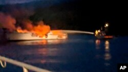 Photo provided by the Santa Barbara County Fire Department shows firefighters working to extinguish a dive boat after a deadly fire broke out aboard the commercial scuba diving vessel off the Southern California Coast, Sept. 2, 2019.