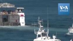 Des migrants tunisiens sont pris en charge par les secours à Lampedusa