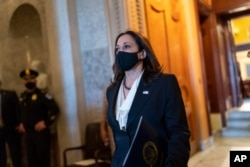 Vice President-elect Sen. Kamala Harris, D-Calif., walks from the Senate chamber after voting against President Donald Trump's choice for the Federal Reserve Board of Governors, Judy Shelton, at the Capitol in Washington, November 17, 2020.