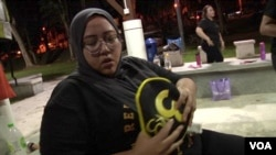 Sarah Baharudin, age 35, like many Malaysians has been leading an inactive lifestyle and eating unhealthy food for most of her life. Approximately half of the country's adults and about 30% of the youth are overweight or obese. (David Grunebaum/VOA)