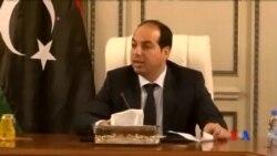 2014-06-03 美國之音視頻新聞: 利比亞新總理在警察護送下進入辦公室