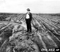 Hugh Haskell Bennett stands in a heavily eroded farm field near Haskell, Oklahoma, in 1943.
