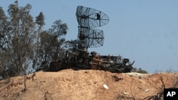 Damaged radars are seen in Tripoli as part of a guided tour for journalists, March 25, 2011