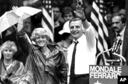 FILE - Democratic presidential candidate Walter Mondale and his running mate, Geraldine Ferraro, wave as they leave an afternoon rally in Portland, Ore., Sept. 5, 1984.