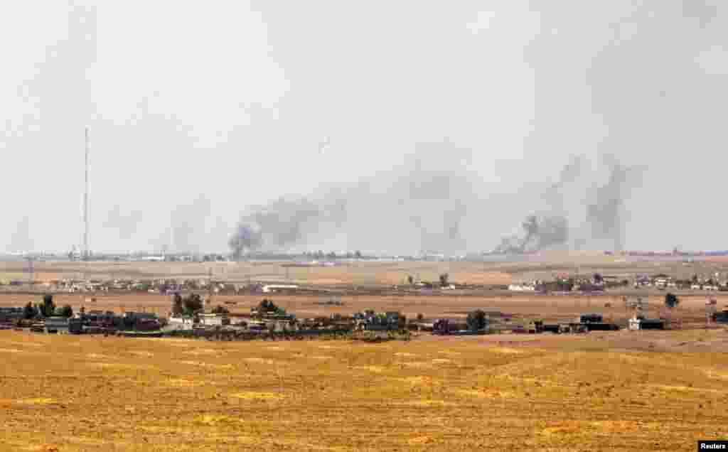 Smoke billows after American air strikes in Khazir, Sept. 16, 2014.