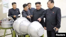 North Korean leader Kim Jong Un provides guidance with Ri Hong Sop (2nd L) and Hong Sung Mu (R) on a nuclear weapons program in this undated photo released by North Korea's Korean Central News Agency (KCNA) in Pyongyang, Sept. 3, 2017.