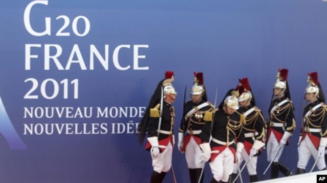 People walk down a stairway at the G20 press center in Cannes, France on Wednesday, Nov. 2, 2011.