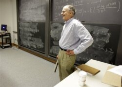Thomas Sargent, 68, a professor at Princeton University, pauses as his students clap in his honor during class