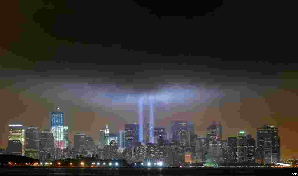 "The ""Tribute in Lights"" is illuminated next to One World Trade Center. marking the 10th anniversary of the 9/11 attacks on the World Trade Center, New York, Sept. 11, 2011. (Reuters)"