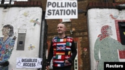 A man wearing a European themed cycling jersey leaves after voting at a polling station for the Referendum on the European Union in north London, Britain, June 23, 2016.