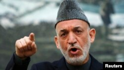 Afghan President Hamid Karzai speaks during a news conference in Kabul, May 4, 2013.