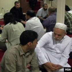 A student conversing with an elderly at Golden Islamic Center, Colorado.