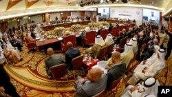 Foreign officials meet for the opening session of the Economic and Social Council of the Arab League Ministers in Kuwait City, March 22, 2014, ahead of the 25th Arab summit in Kuwait, March 25-26.
