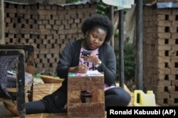 Stella Maris Basemera, a mathematics teacher who heads a Uganda-based group of tutors called Creative Learning Africa, writes work for students to complete which she sends them as a private tutor via WhatsApp, at her home just outside Kampala, Uganda.