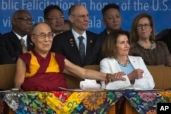 Tibetan spiritual leader Dalai Lama holds the arm of U.S. House Minority Leader Nancy Pelosi at the Tsuglagkhang temple in Dharmsala, India, May 10, 2017.