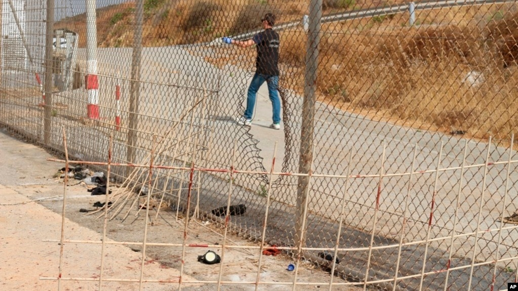 Image released by the Spanish Guardia Civil on Aug. 22, 2018 shows damage done to a fence dividing the Spanish enclave of Ceuta and Morocco.