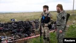 Armed pro-Russian separatists guard the crash site of Malaysia Airlines Flight MH17 in Donetsk region July 22, 2014.