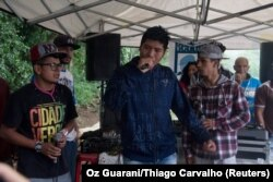"Indigenous rap group Oz Guarani sings during the event ""Culture and Concept"" at indigenous community Tekoa Itakupe in the city of Sao Paulo, claiming for land demarcation, Oct. 22, 2017."