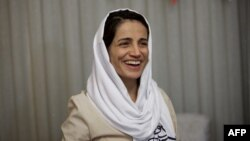 FILE - Iranian lawyer Nasrin Sotoudeh smiles at her home in Tehran, Sept. 18, 2013, after being freed following three years in prison. Iranian security agents re-arrested Sotoudeh at her home on June 13, 2018.