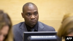 FILE - Germain Katanga, a Congolese National, sits during his trial at the International Criminal Court (ICC) in the Hague, May 23, 2014.