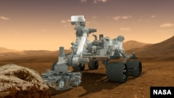 """A nave robótica """"Curiosity"""" dotada de dezenas de instrumentos científicos, aqui representada num desenho da NASA"""