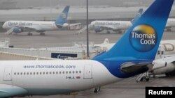 FILE - Thomas Cook aircraft are seen parked on the tarmac at Manchester airport in Manchester, Britain, Nov. 22, 2011.