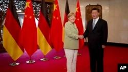 2014年,德國總理默克爾訪問中國與習近平會面。(資料圖片)