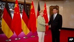 Thủ tướng Đức Angela Merkel và Chủ tịch Trung Quốc Tập Cận Bình tại Bắc Kinh, ngày 7/7/2014.