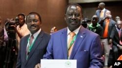 Orange Democratic Party, ODM, presidential candidate, Raila Odinga, right, displays his registration certificate, with running mate Vice President Kalonzo Musyoka, left, in Nairobi, Kenya, Jan. 30. 2013.