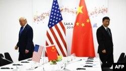 2019年6月29日美国总特朗普(左)和中国国家主席习近平(右)在G20大阪峰会。