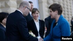 Czech Republic Prime Minister Bohuslav Sobotka, left, welcomes Polish Prime Minister Beata Szydlo at the summit of leaders of the Visegrad 4 group in Prague, Czech Republic, Dec. 3, 2015.