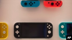 FILE - In this Thursday, Jan, 23, 2020 file photo, Nintendo Switch game consoles are on display at Nintendo's official store in the Shibuya district of Tokyo.