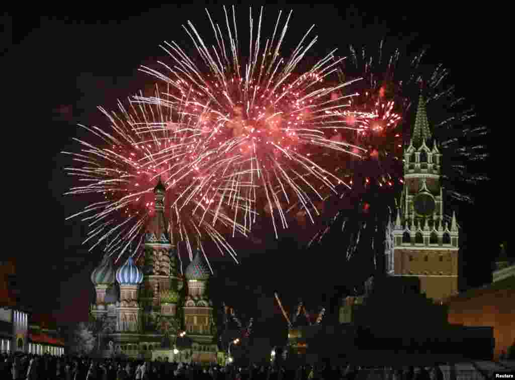 Fireworks explode in the sky during New Year celebrations in Moscow's Red Square, Russia.