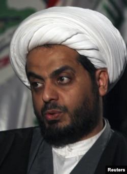 Iraq's Shi'ite militia leader Qais al-Khazali, the leader of Asaib al-Haq, speaks to Reuters during an interview in Baghdad, Iraq, January 4, 2012.