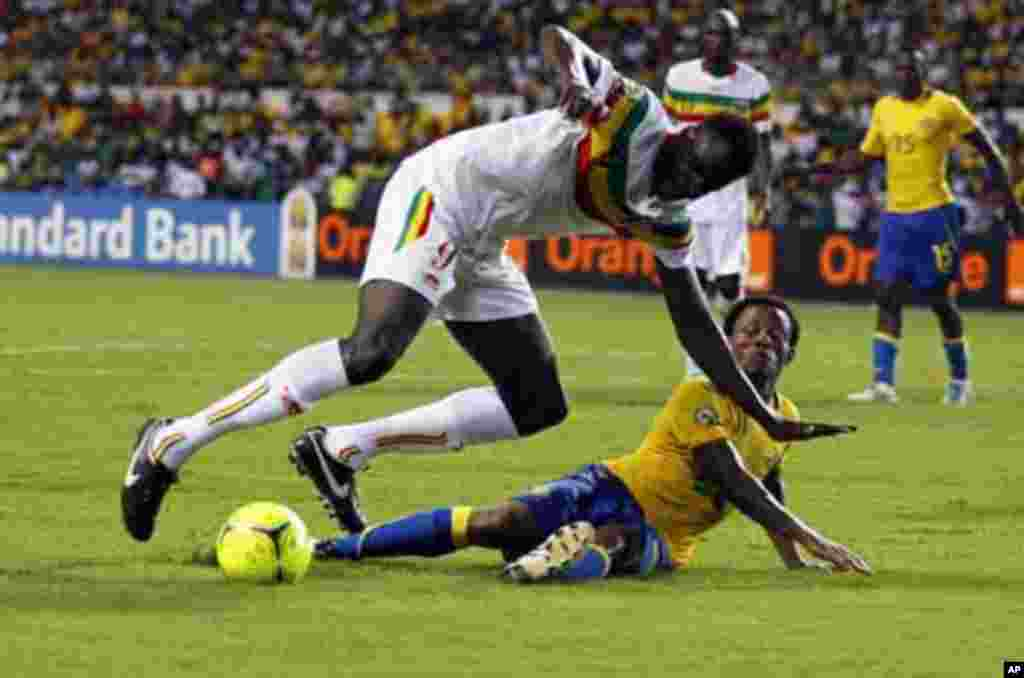 Mali's Cheick Diabate (L) is tackled by Gabon's Charly Moussono during their African Cup of Nations quarter-final soccer match at the Stade De L'Amitie Stadium in Gabon's capital Libreville, February 5, 2012.