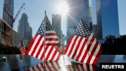 U.S. flags are seen at the 9/11 Memorial on the 20th anniversary