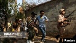 ایران کے شہر اہواز میں ایک فوجی پریڈ پر حملے کے بعد کا ایک منظر۔ 22 مئی 2018