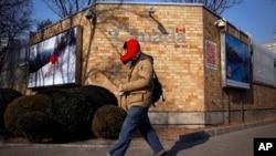 A man walks by the Canadian Embassy in Beijing, Dec. 14, 2018.